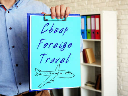 Financial concept meaning Cheap Foreign Travel with sign on the sheet.