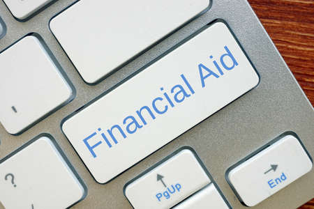 Financial concept meaning Financial Aid with inscription on the piece of paper.
