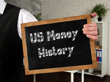 Business concept about Us Money History with sign on the page.