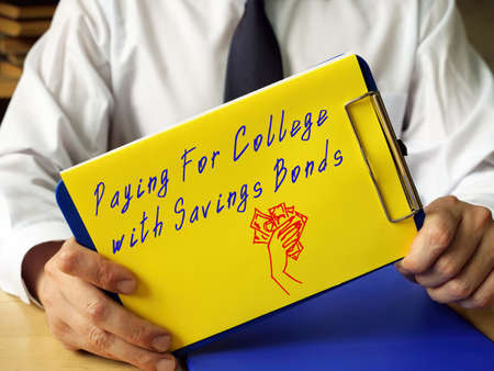 Financial concept meaning Paying For College With Savings Bonds with phrase on the sheet.