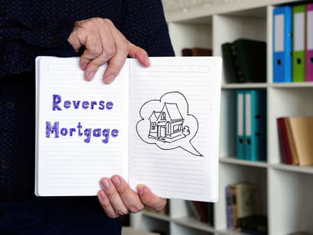 Business concept meaning Reverse Mortgage with sign on the sheet.