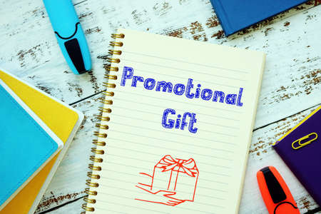 Business concept about Promotional Gift with inscription on the sheet.