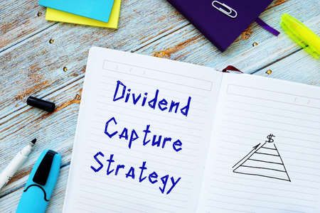 Conceptual photo about Dividend Capture Strategy with handwritten phrase. 스톡 콘텐츠