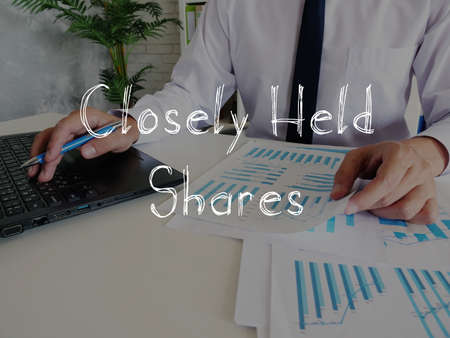 Business concept about Closely Held Shares with sign on the piece of paper. 스톡 콘텐츠