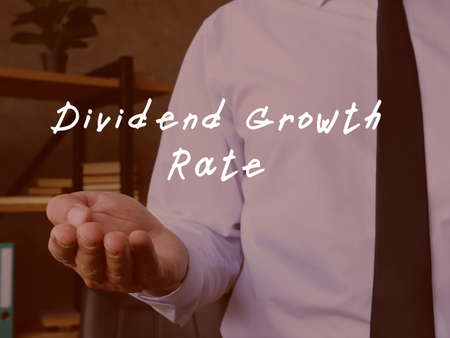 Conceptual photo about Dividend Growth Rate with handwritten phrase.
