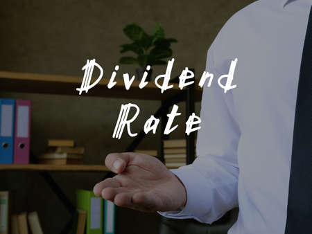 Business concept meaning Dividend Rate with sign on the sheet.