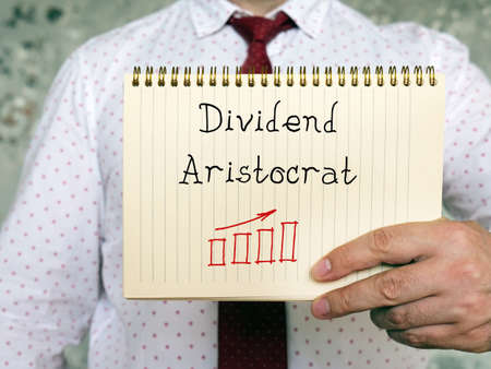 Dividend Aristocrat phrase on the sheet. 스톡 콘텐츠