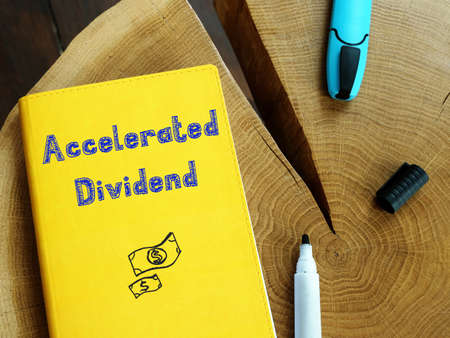 Business concept about Accelerated Dividend with inscription on the sheet.
