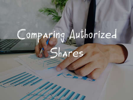 Business concept about Comparing Authorized Shares with sign on the sheet. 스톡 콘텐츠