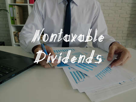 Financial concept meaning Nontaxable Dividends with sign on the piece of paper.