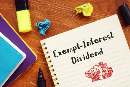 Business concept meaning Exempt-Interest Dividend with sign on the sheet. 스톡 콘텐츠
