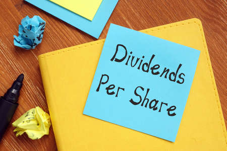 Financial concept meaning Dividends Per Share with inscription on the piece of paper.