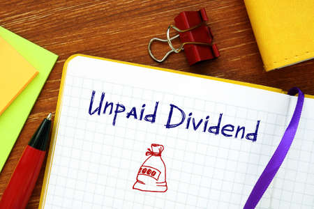 Business concept meaning Unpaid Dividend with phrase on the sheet.