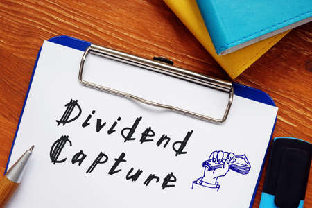 Financial concept meaning Dividend Capture with sign on the page. 스톡 콘텐츠