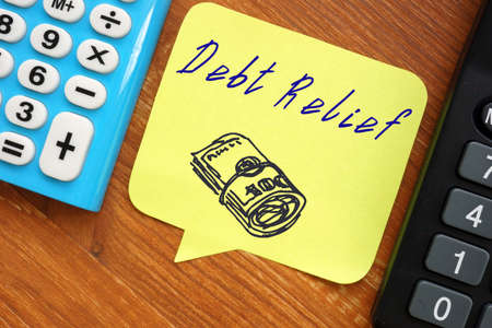 Financial concept meaning Debt Relief with sign on the piece of paper. Stok Fotoğraf