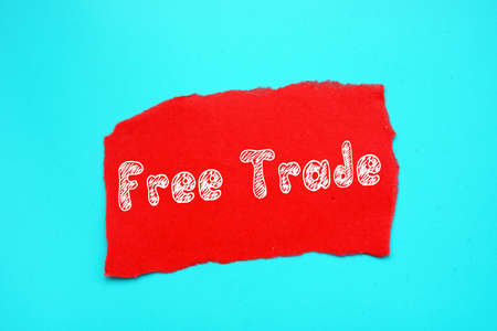 Financial concept meaning Free Trade with phrase on the piece of paper.