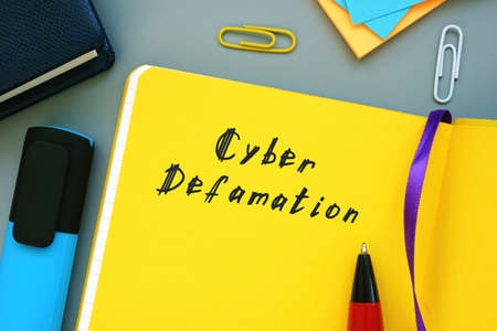 Business concept meaning Cyber Defamation with inscription on the piece of paper. Stok Fotoğraf