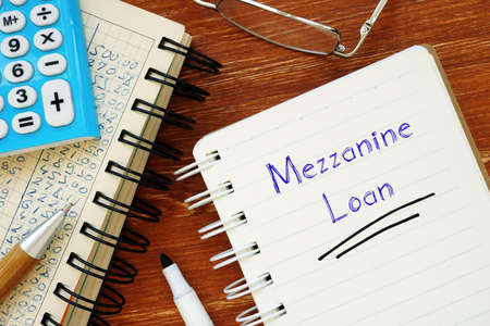 Financial concept about Mezzanine Loan with inscription on the piece of paper.