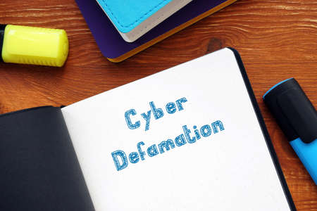 Financial concept about Cyber Defamation with phrase on the page.