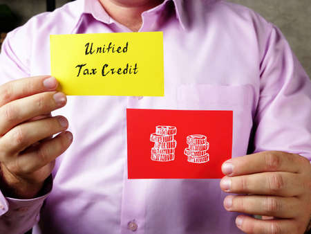 Business concept about Unified Tax Credit with inscription on the page.