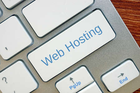 Financial concept meaning Web Hosting  with phrase on the piece of paper.