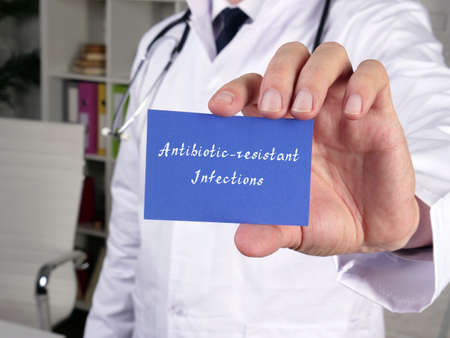 Health care concept about Antibiotic-resistant Infections with phrase on the piece of paper.