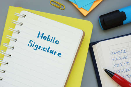 Financial concept about Mobile Signature with inscription on the sheet.