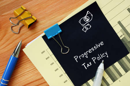 Financial concept about Progressive Tax Policy with sign on the piece of paper.