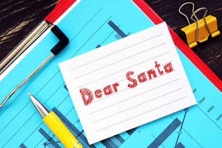 Business concept meaning Dear Santa  with phrase on the piece of paper. Stock Photo