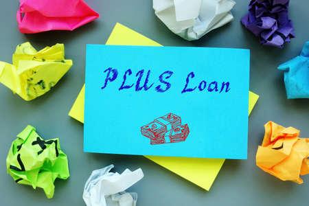 PLUS Loan phrase on the sheet. Foto de archivo