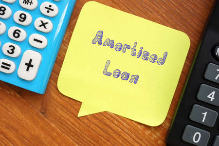 Financial concept about Amortized Loan with sign on the page.