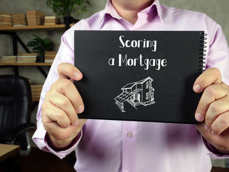 Business concept about Scoring a Mortgage with phrase on the sheet.