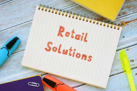 Business concept meaning Retail Solutions with sign on the page.