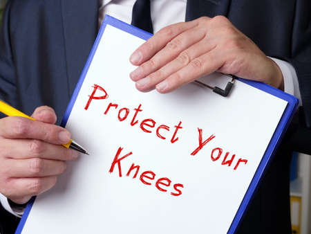 Business concept about Protect Your Knees with inscription on the piece of paper.