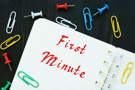 Financial concept meaning First Minute with phrase on the piece of paper. Stockfoto