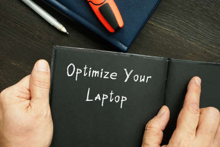 Lifestyle concept meaning Optimize Your Laptop with phrase on the sheet.
