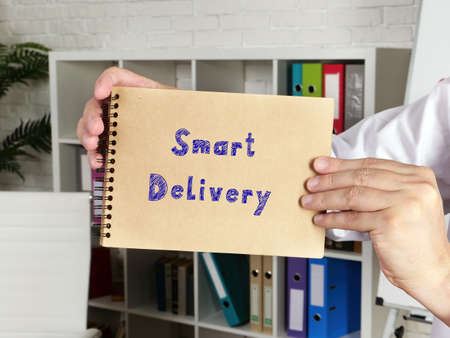 Business concept about Smart Delivery with inscription on the piece of paper.
