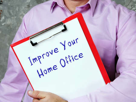 Motivational concept about Improve Your Home Office with sign on the sheet. Stockfoto