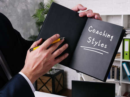 Business concept meaning Coaching Styles with sign on the sheet.