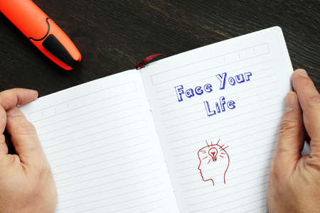 Lifestyle concept about Face Your Life with inscription on the piece of paper.