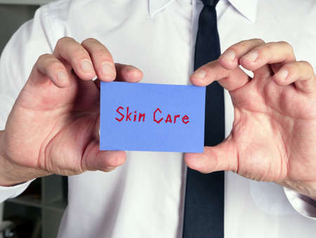 Business concept meaning  Skin Care    with phrase on the piece of paper. Imagens