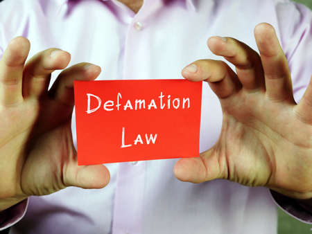 Business concept meaning Defamation Law with phrase on the piece of paper. Stok Fotoğraf