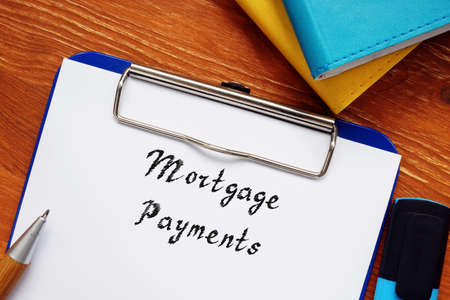 Financial concept meaning Mortgage Payments with sign on the piece of paper.