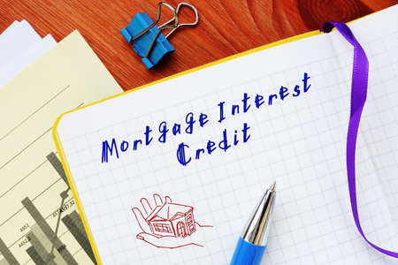 Business concept about Mortgage Interest Credit with sign on the sheet.
