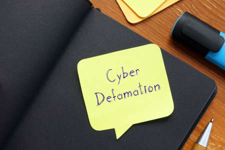 Financial concept about Cyber Defamation with sign on the sheet.
