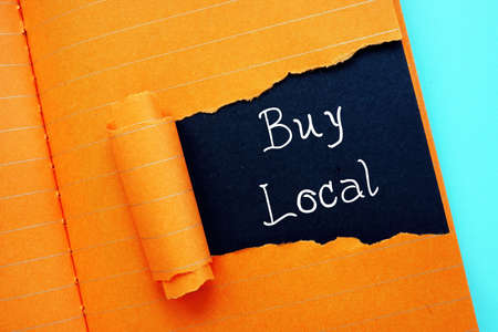 Business concept about Buy Local with sign on the page.