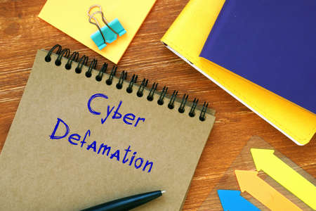 Cyber Defamation phrase on the piece of paper.