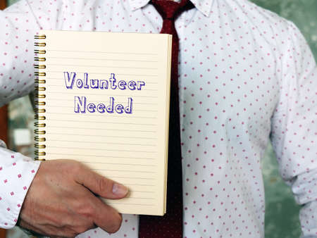 Financial concept meaning Volunteer Needed with inscription on the piece of paper.
