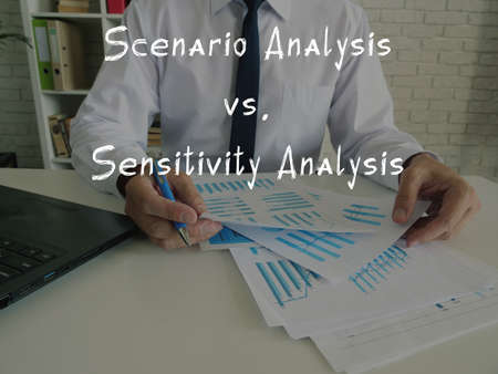 Financial concept about Scenario Analysis vs. Sensitivity Analysis with inscription on the piece of paper. Banque d'images