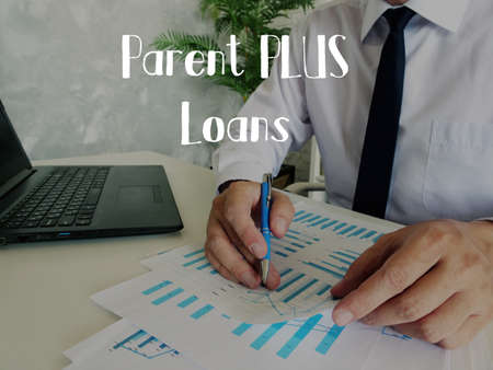 Business concept about Parent PLUS Loans with sign on the sheet.